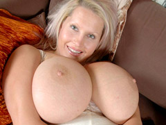 Adorable blonde milf undressing and exposing her unbelievable juggs.
