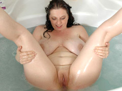 Chubby brunette babe with heavy melons and tight pussy taking a bath.